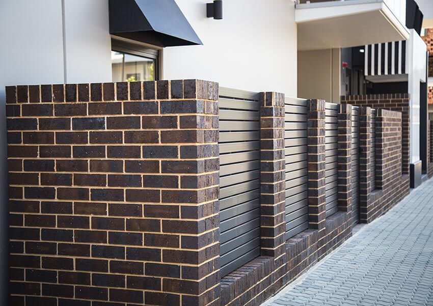 Bowden Coachhouse Dark Brick On Modern Apartment Building Wall 20