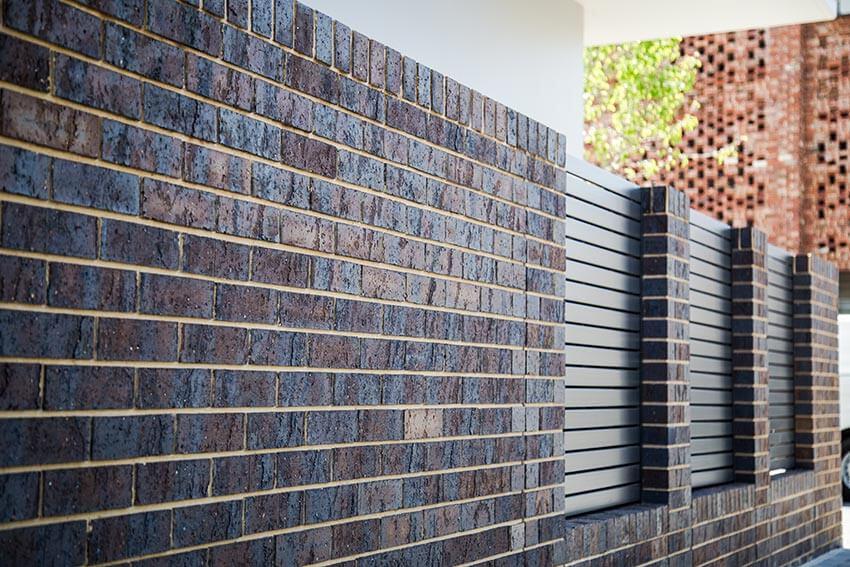 Bowden Coachhouse Dark Brick On Modern Apartment Building Wall 25