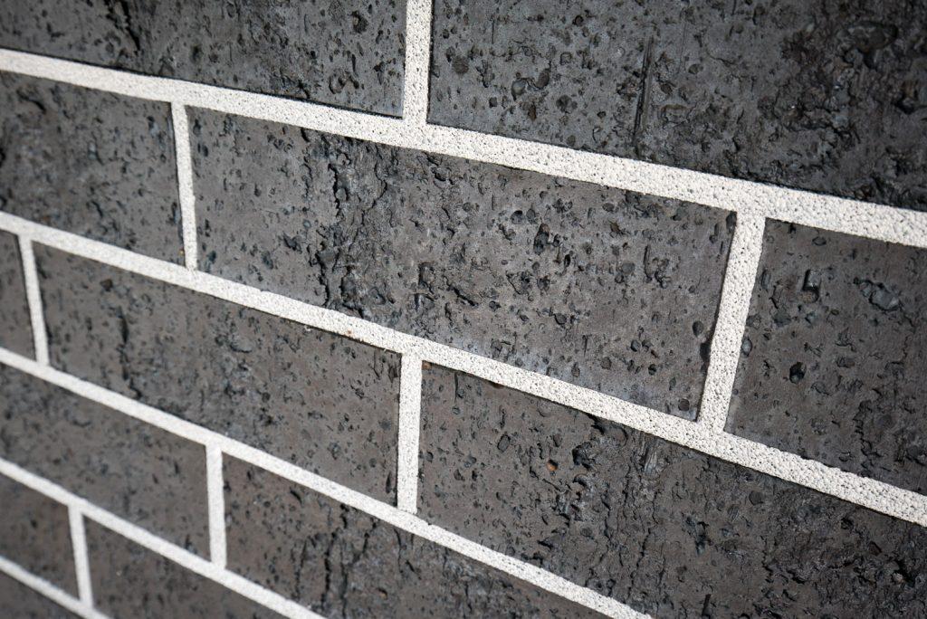 Midnight Black Brick Wall Reduced Size 16
