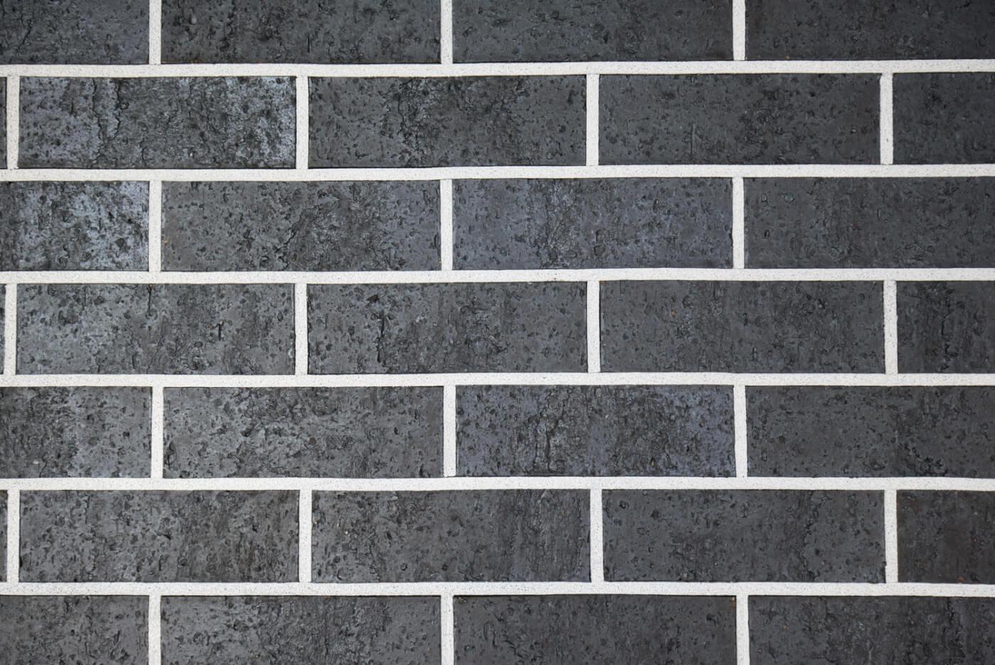 Midnight Black Brick Wall Reduced Size